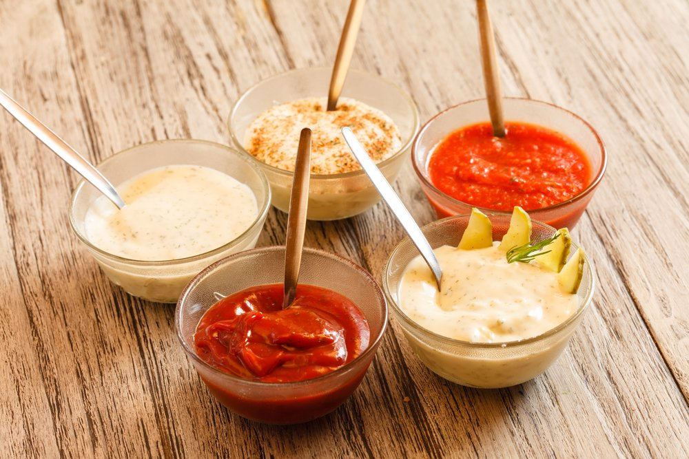 A selection of five sauces in bowls