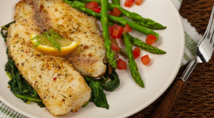 A plate of healthy Tilapia served with asparagus