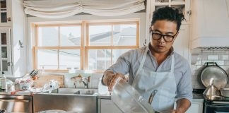 Viet Pham cooking with Tilapia