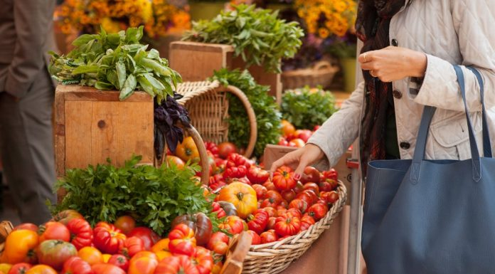 Woman selecting vegetables at a market