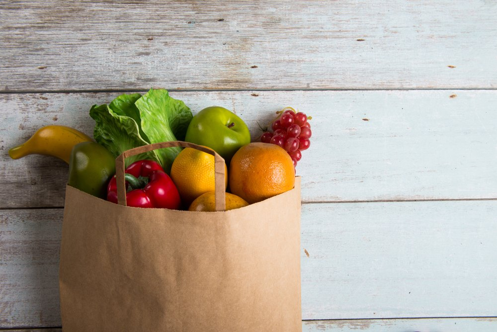 Grocery Bag Full Of Healthy Foods For Meal Planning