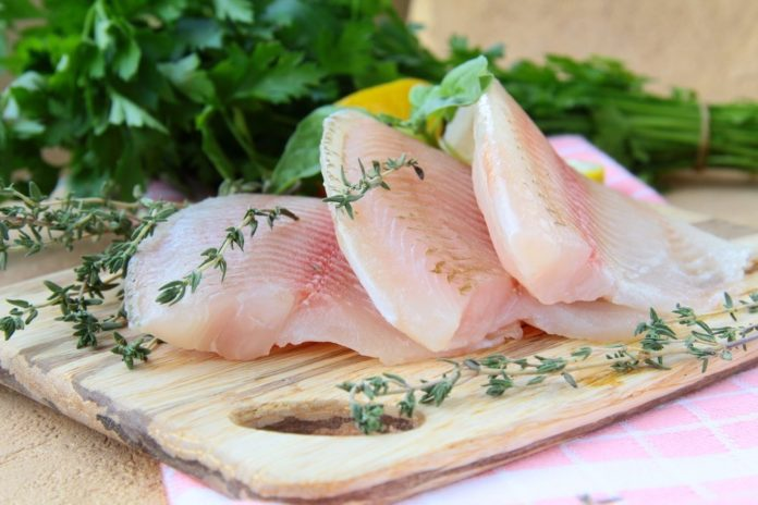 Healthy fish fillets on chopping board