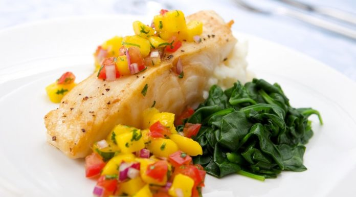 Healthy fish dish with fruits and vegetables