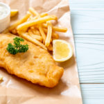 Fish and chips with tartar sauce and lemon slices