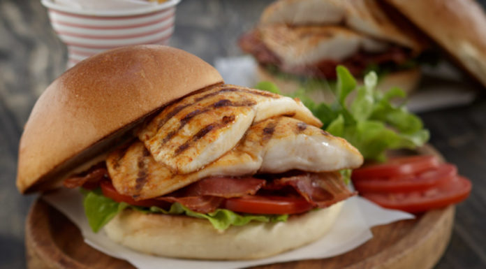 Grilled Tilapia sandwich with bacon, lettuce, and tomato