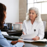 Brunette woman in a consultation at doctor's office