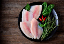 Raw Tilapia fillets with herbs and spices