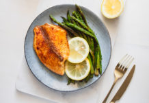 Roasted tilapia fish with asparagus
