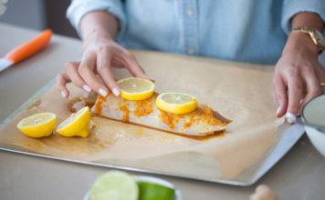 Woman preparing fish dinner