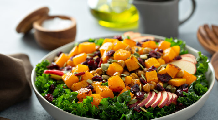 Salad with kale, roasted squash, pumpkin seeds and apples