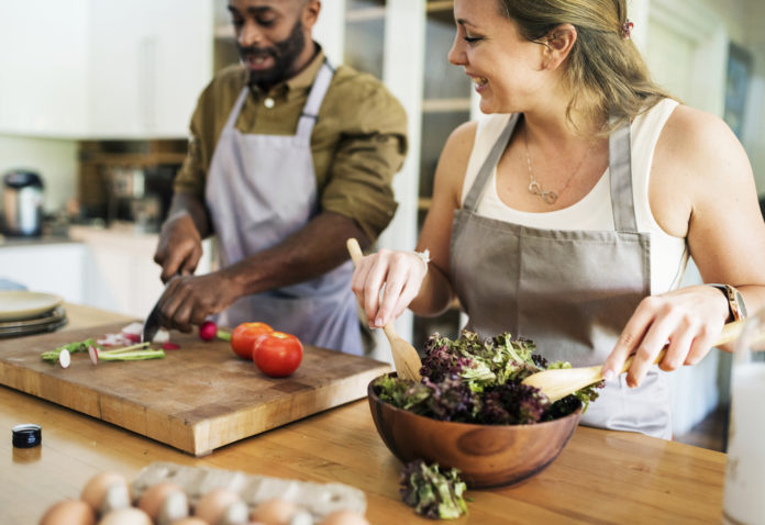 Couple prepping food in kitchen together