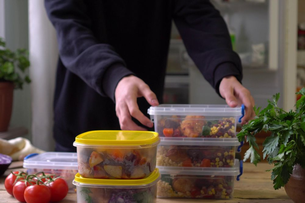 Man organizing meal prep containers