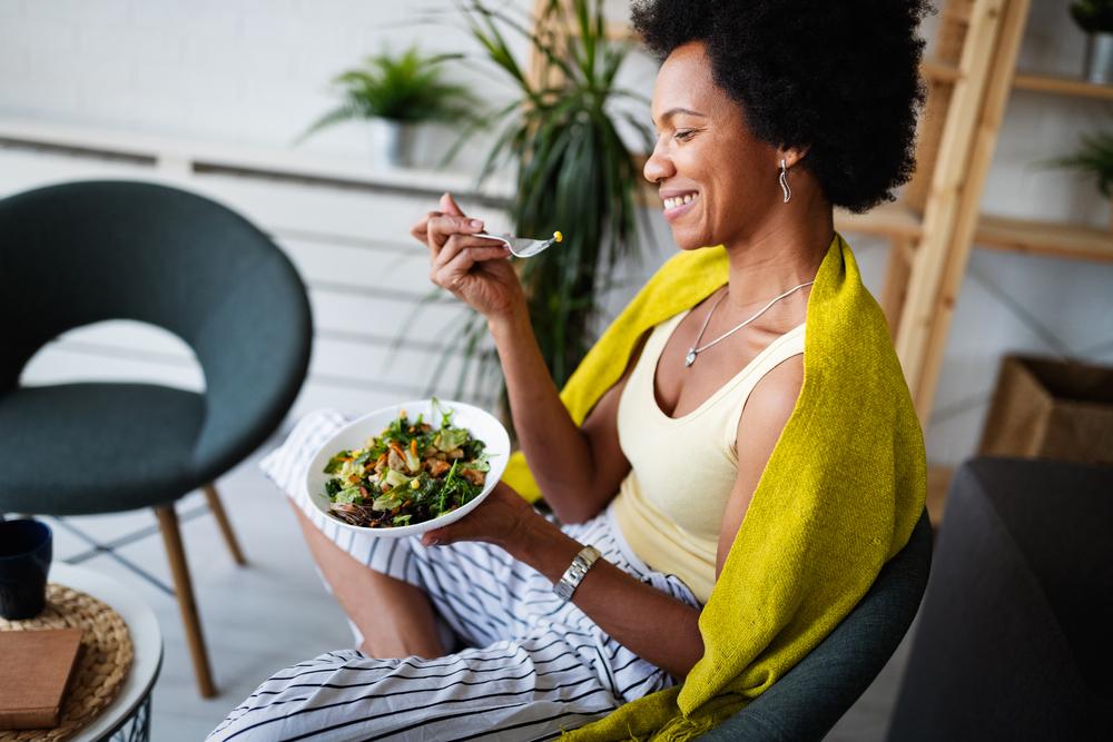 Woman enjoying salad at home