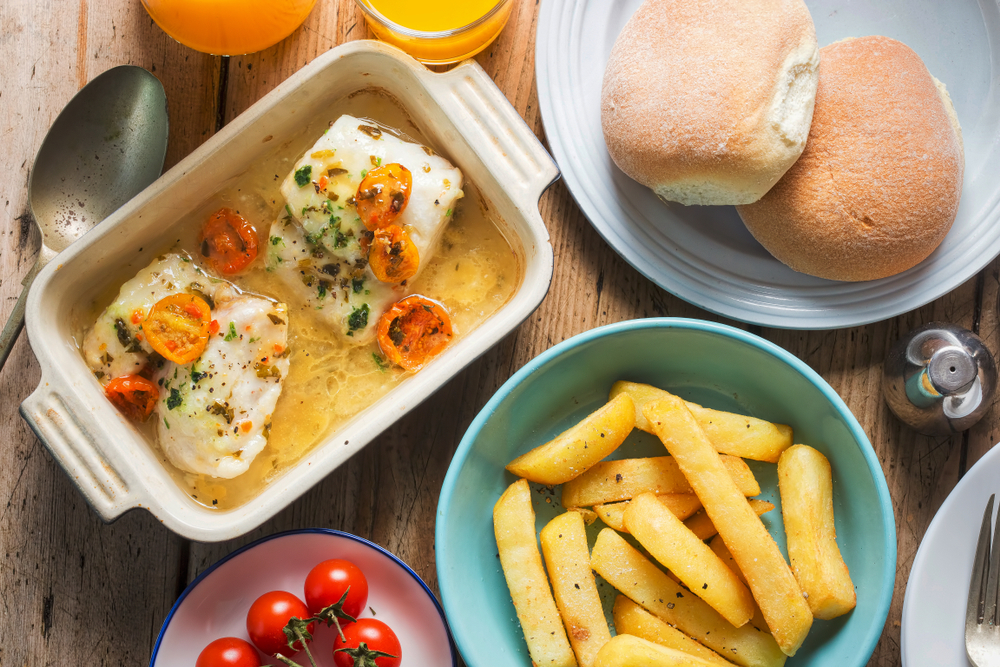 Baked fish with cherry tomatoes and French fries