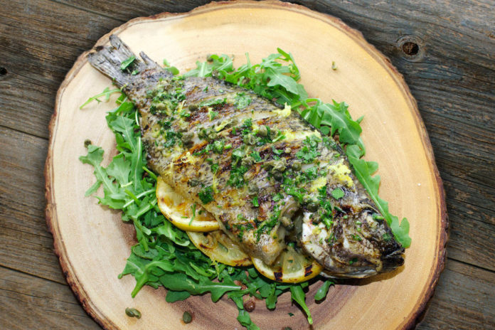 Grilled whole Tilapia with lemon butter and caper sauce