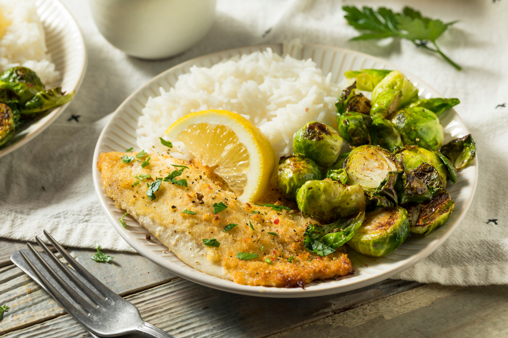 Baked fish with rice and Brussels sprouts