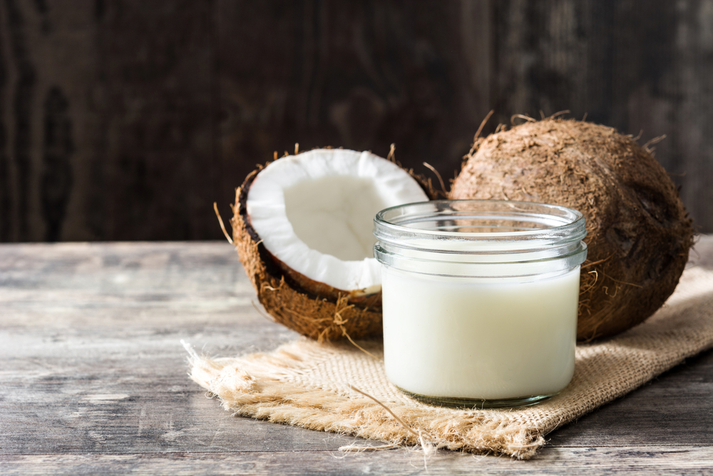 Coconut milk on wooden table