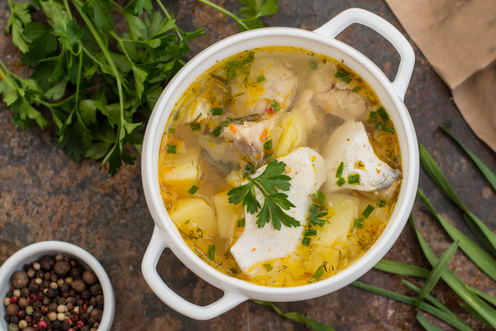 Fresh fish soup with spices and herbs