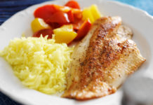Fried tilapia fillet with rice and vegetables